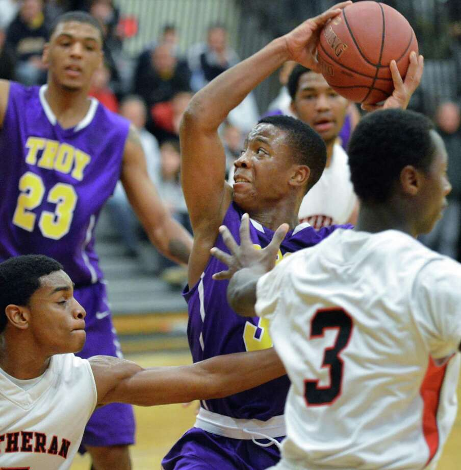 Troy's #35 Isiah Dobere goes to the hoop against Long Island Lutheran at the College of Saint Rose in Albany Saturday Dec. 22, 2012.  (John Carl D'Annibale / Times Union) Photo: John Carl D'Annibale / 00020524A