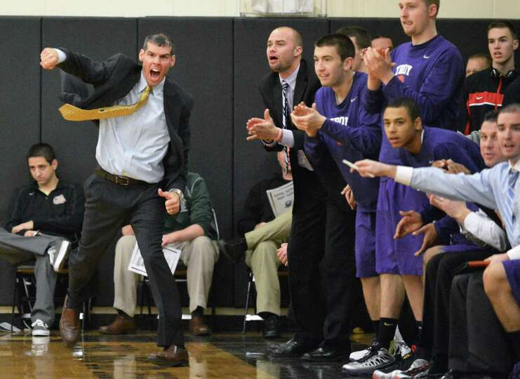 Troy head coach Richard Hurley, left, and the Troy bench cheers their team during Saturday's game ag