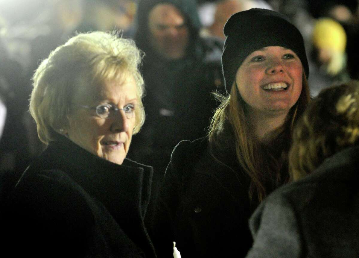 Newtown First Selectman Pat Llodra, left, stands with Sarah Ferris before a candle light vigil on the soccer fields of Fairfield Hills Campus in Newtown on Friday, Dec. 21, 2012, one week after the Sandy Hook Elementary School shooting. Ferris helped set up the vigil.