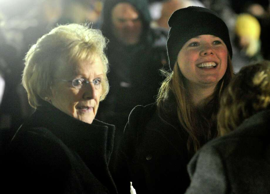Newtown First Selectman Pat Llodra, left, stands with Sarah Ferris before a candle light vigil on the soccer fields of Fairfield Hills Campus in Newtown on Friday, Dec. 21, 2012, one week after the Sandy Hook Elementary School shooting. Ferris helped set up the vigil. Photo: Jason Rearick, Staff Photographer / The News-Times