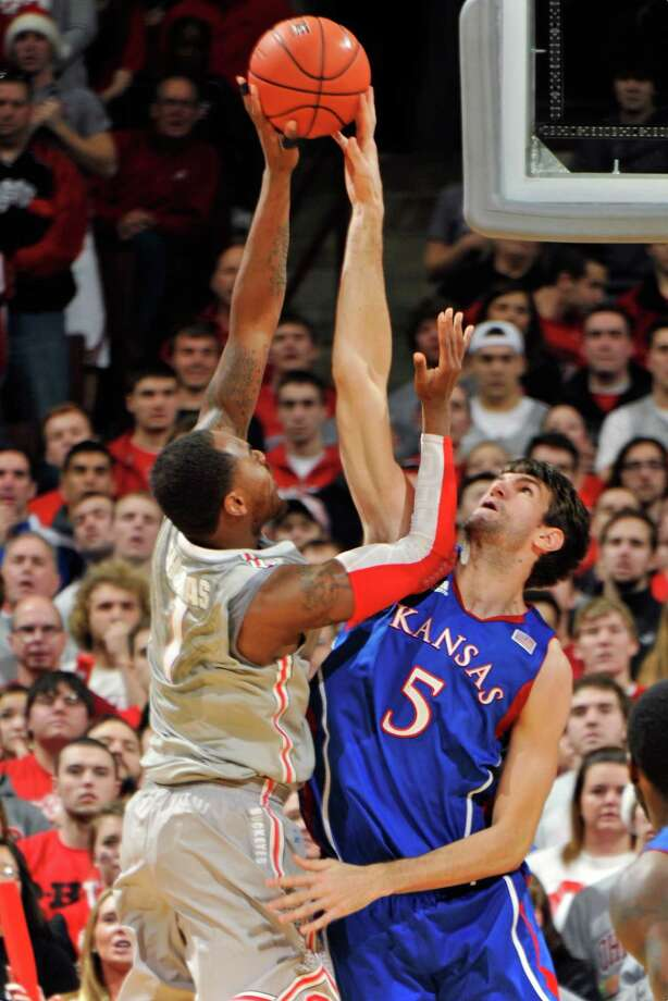 COLUMBUS, OH - DECEMBER 22:  Jeff Withey #5 of the Kansas Jayhawks blocks a shot by Deshaun Thomas #1 of the Ohio State Buckeyes in the first half on December 22, 2012 at Value City Arena in Columbus, Ohio.  (Photo by Jamie Sabau/Getty Images) Photo: Jamie Sabau