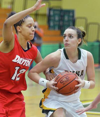 Siena's #40 Clara Sole Anglada is closely guarded by Dayton's #12 Jodie Cornelie, left, during Saturday's game at Siena College in Colonie Dec. 22, 2012.  (John Carl D'Annibale / Times Union) Photo: John Carl D'Annibale / 00020489A