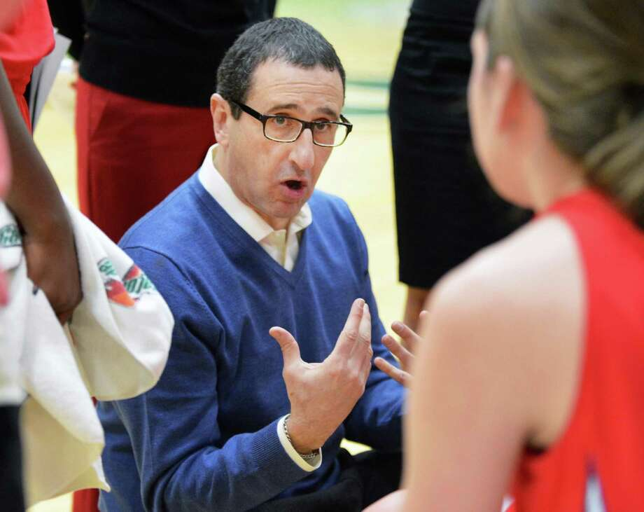 Dayton head coach Jim Jabir with players during a time out in Saturday's game at Siena College in Colonie Dec. 22, 2012.  (John Carl D'Annibale / Times Union) Photo: John Carl D'Annibale / 00020489A