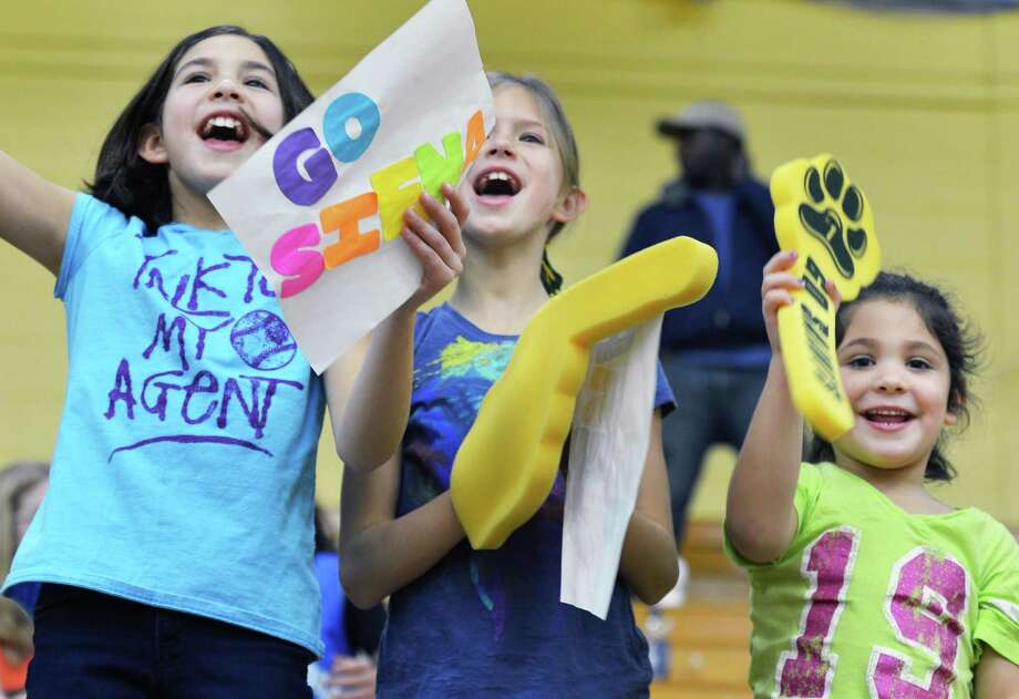 Siena womens basketball fans , from left, Callie Chevalier,8. Carlie Rzeszotav, 8 and Sophie Chevalier,5, all from Burnt Hills, cheer during Saturday's game against Dayton at Siena College in Colonie Dec. 22, 2012.  (John Carl D'Annibale / Times Union) Photo: John Carl D'Annibale / 00020489A