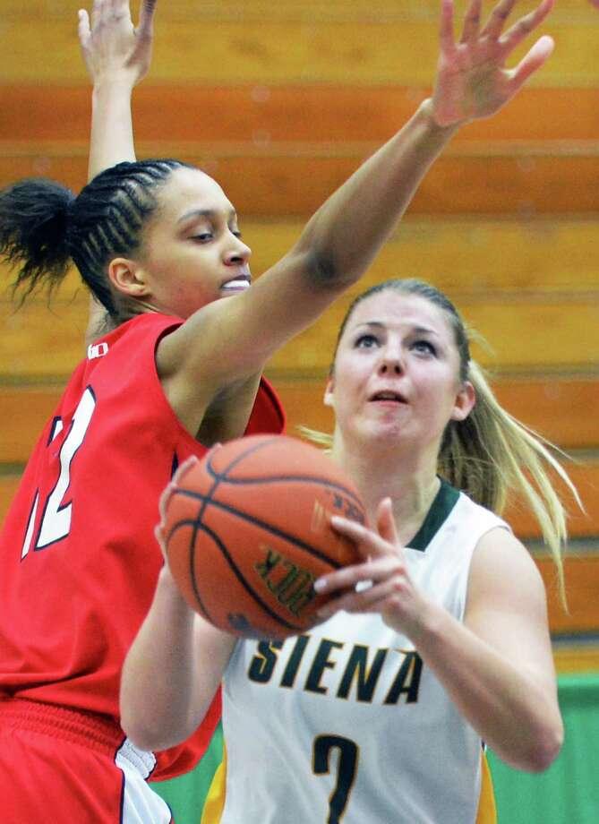 Siena's #2 Ida Krogh gets under Dayton's #12 Jodie Cornelie, left, during Saturday's game at Siena College in Colonie Dec. 22, 2012.  (John Carl D'Annibale / Times Union) Photo: John Carl D'Annibale / 00020489A