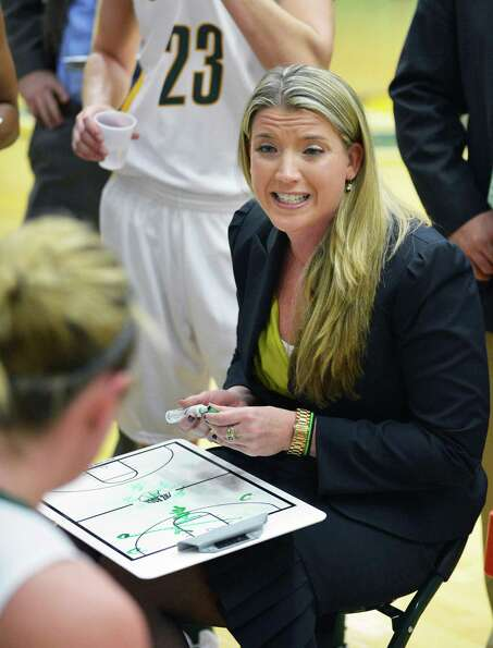 Siena head coach Ali Jaques with players during a time out in Saturday's game against Dayton at Sien