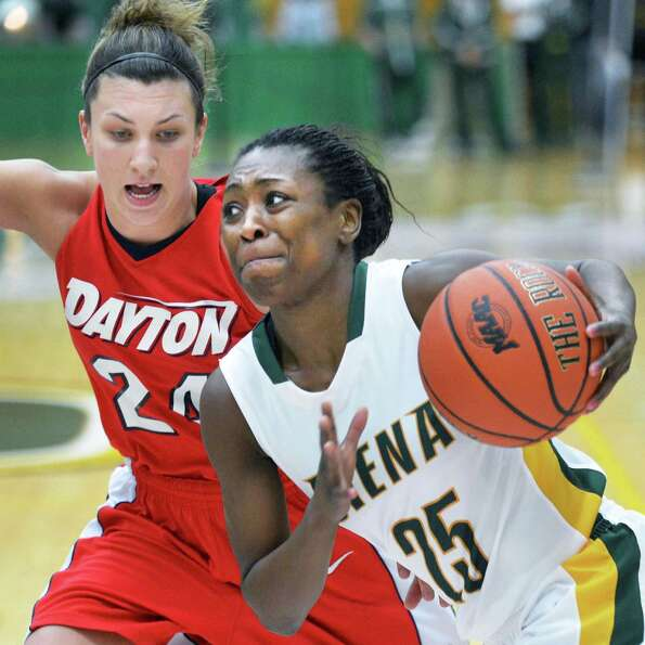 Siena's #25 Tehresa Coles drives by Dayton's #24 Andrea Hoover, left, during Saturday's game at Sien
