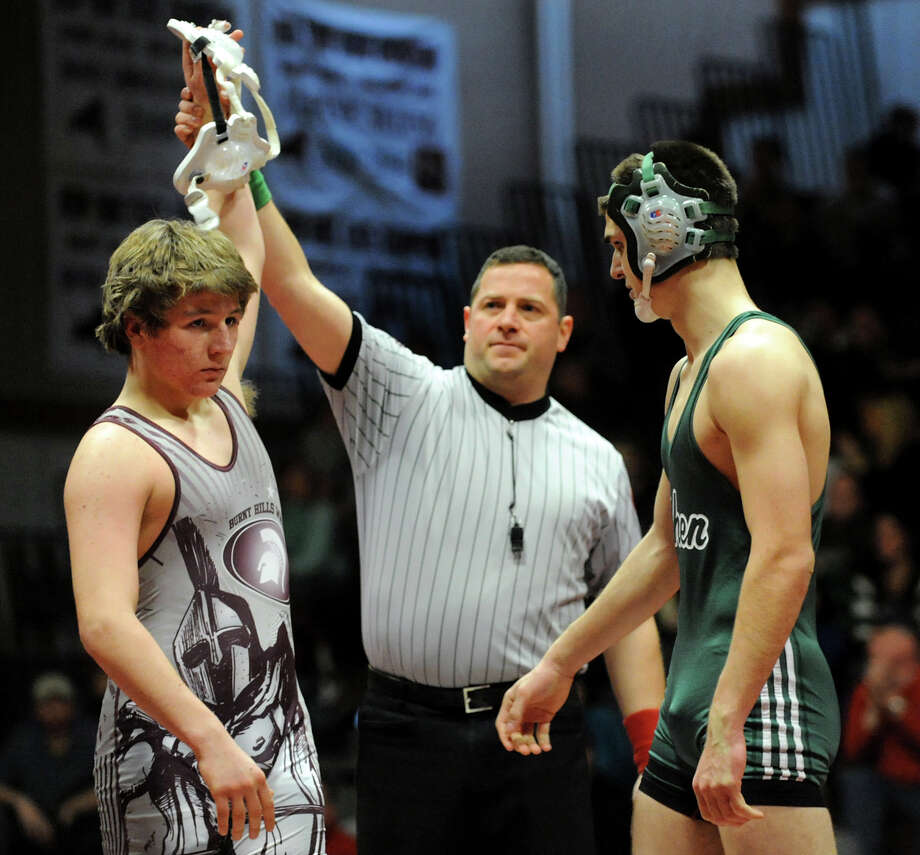 Burnt Hills' Jack Hatton, left, is declared the winner against Shenendehowa's Bryant Gallagher at 170 pounds during their match on Saturday, Dec. 22, 2012, at Burnt Hills High in Burnt Hills, N.Y. Hatton wins with a pin. (Cindy Schultz / Times Union) Photo: Cindy Schultz / 00020546A