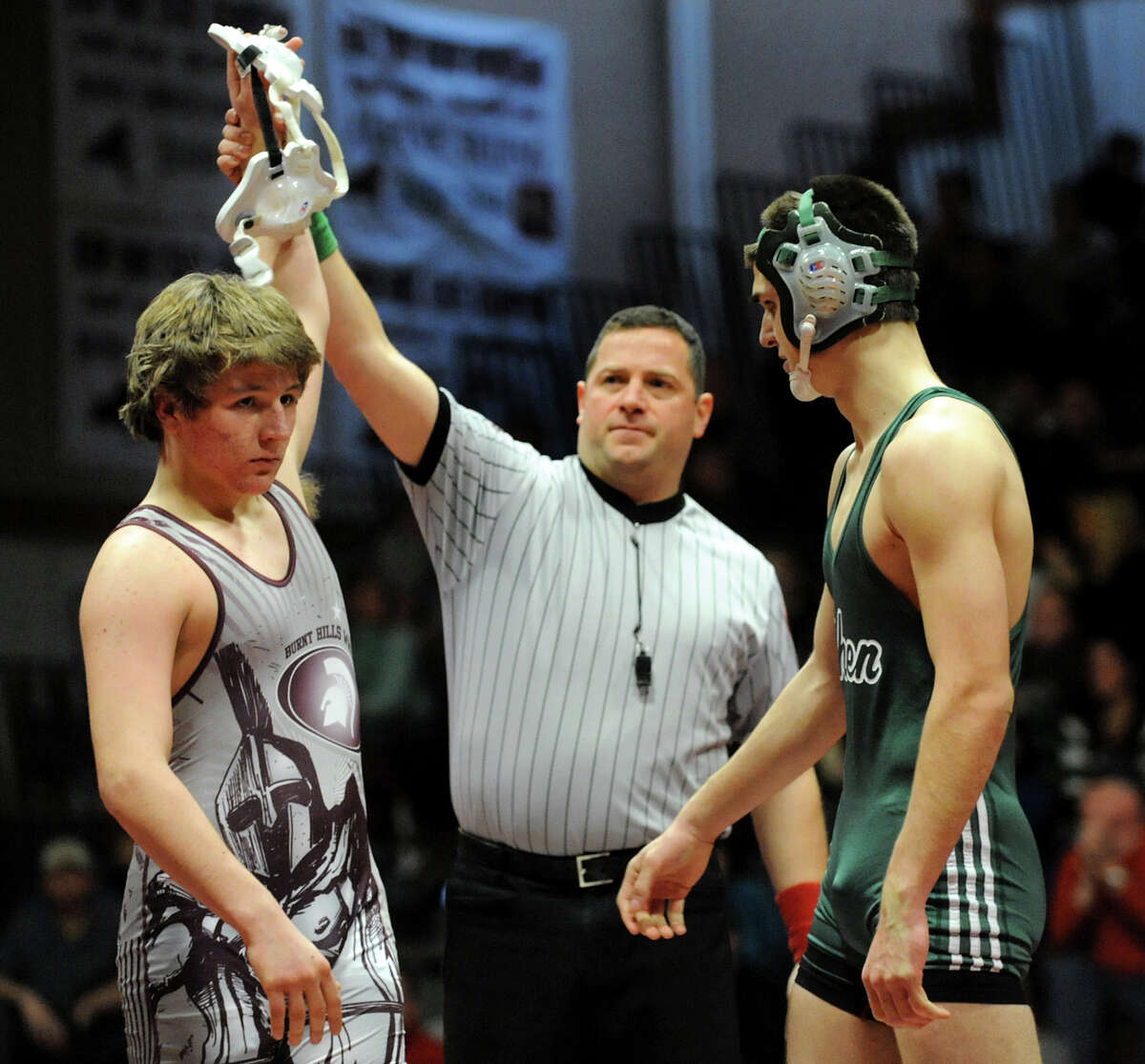 Burnt Hills' Jack Hatton, left, is declared the winner against Shenendehowa's Bryant Gallagher at 170 pounds during their match on Saturday, Dec. 22, 2012, at Burnt Hills High in Burnt Hills, N.Y. Hatton wins with a pin. (Cindy Schultz / Times Union)