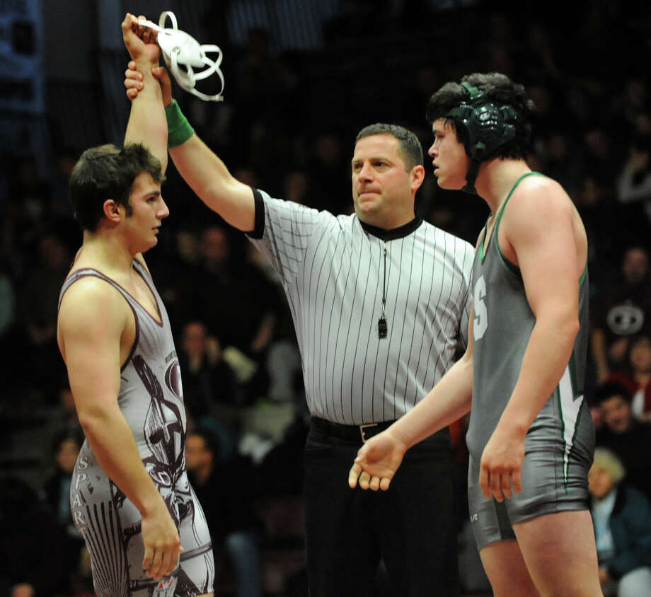Burnt Hills' Race Viedt, left, is declared the winner against Shenendehowa's Kevin Leonard at 220 pounds during their match on Saturday, Dec. 22, 2012, at Burnt Hills High in Burnt Hills, N.Y. (Cindy Schultz / Times Union) Photo: Cindy Schultz / 00020546A