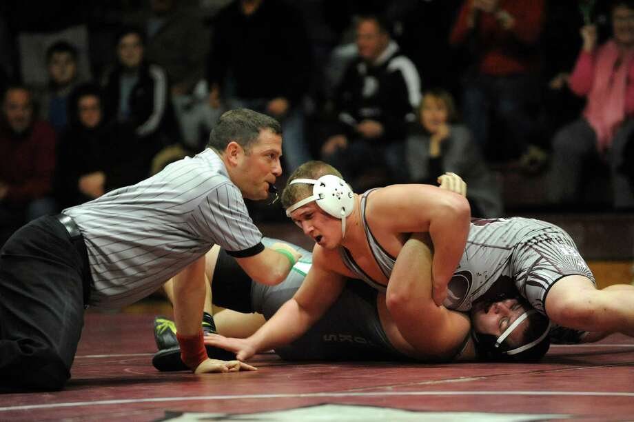 Burnt Hills' Nico Fargale, center, pins Shenendehowa's Jacob Brooks at 285 pounds during their match on Saturday, Dec. 22, 2012, at Burnt Hills High in Burnt Hills, N.Y. (Cindy Schultz / Times Union) Photo: Cindy Schultz / 00020546A