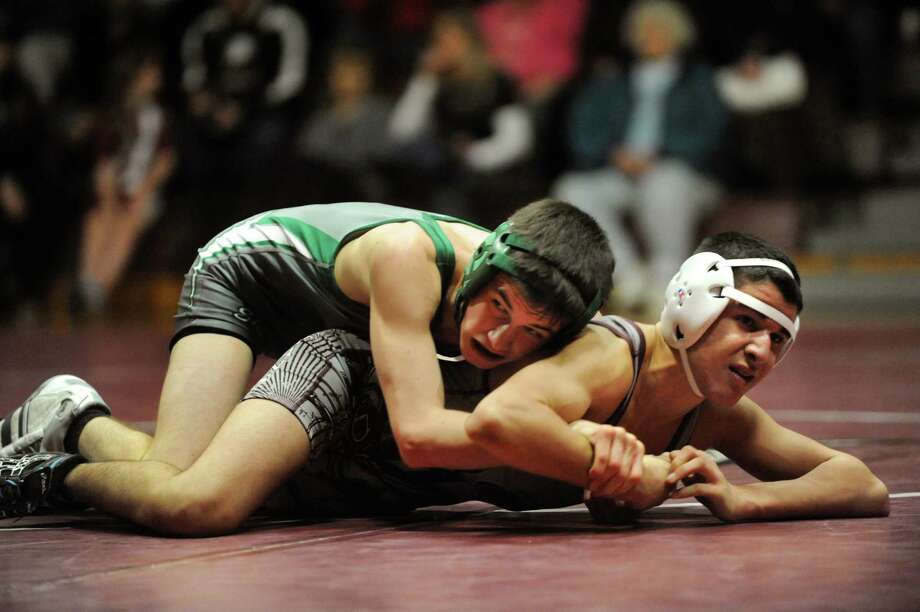 Shenendehowa's Kevin Guardino, left, grapples with Burnt Hills' Nik Martinez at 113 pounds during their match on Saturday, Dec. 22, 2012, at Burnt Hills High in Burnt Hills, N.Y. Guardino wins. (Cindy Schultz / Times Union) Photo: Cindy Schultz / 00020546A