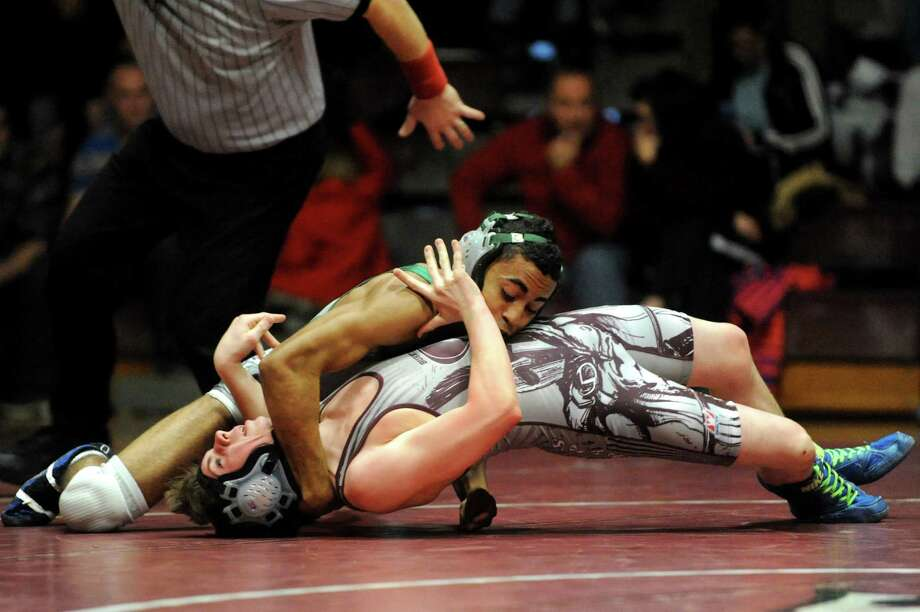Shenendehowa's Corey Ali, left, works to pin Burnt Hills' Austin Rowinski at 120 pounds during their match on Saturday, Dec. 22, 2012, at Burnt Hills High in Burnt Hills, N.Y. (Cindy Schultz / Times Union) Photo: Cindy Schultz / 00020546A