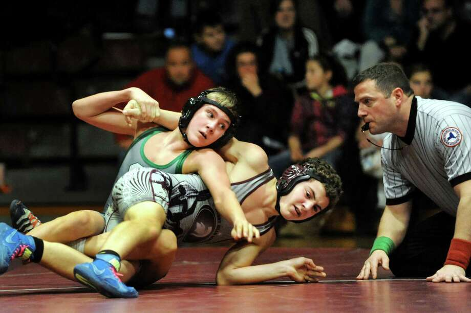 Shenendehowa's Kevin Parker, left, grapples Burnt Hills' Mason Rabideau at 126 pounds during their match on Saturday, Dec. 22, 2012, at Burnt Hills High in Burnt Hills, N.Y. Parker wins with a pin. (Cindy Schultz / Times Union) Photo: Cindy Schultz / 00020546A