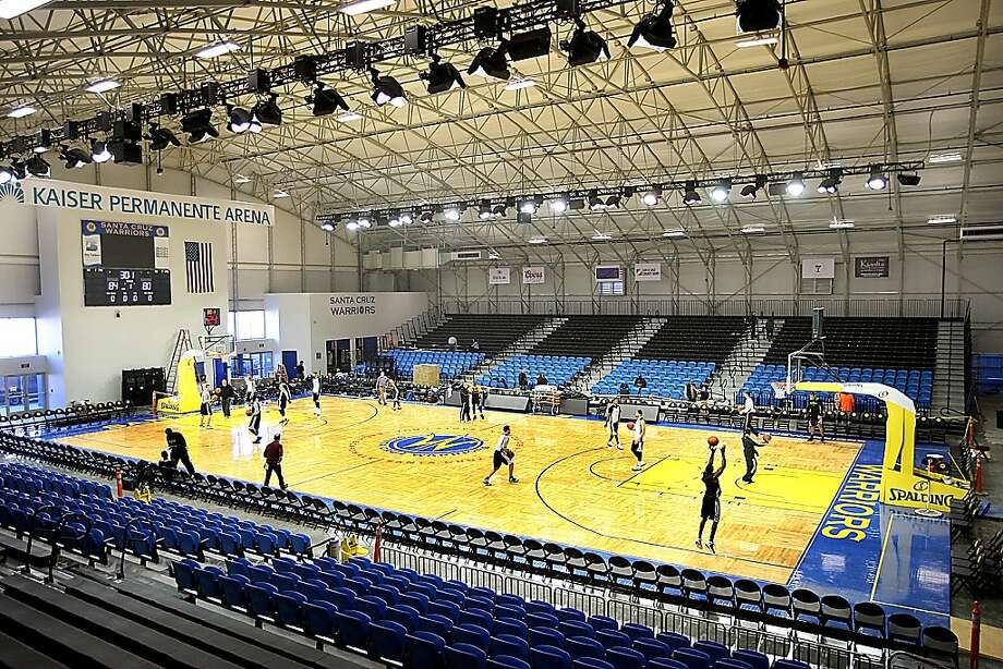 The Santa Cruz Warriors have their first practice in their new arena as last-minute construction continues Thursday. Photo: Dan Coyro, Santa Cruz Sentinel