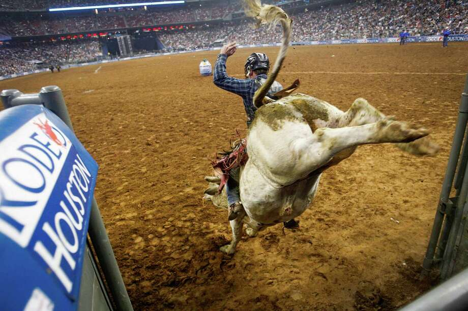 Tag Elliott competes in Bull Riding during BP Super Series at Reliant Stadium on Friday, March 16, 2012, in Houston. Photo: Mayra Beltran, Houston Chronicle / © 2012 Houston Chronicle