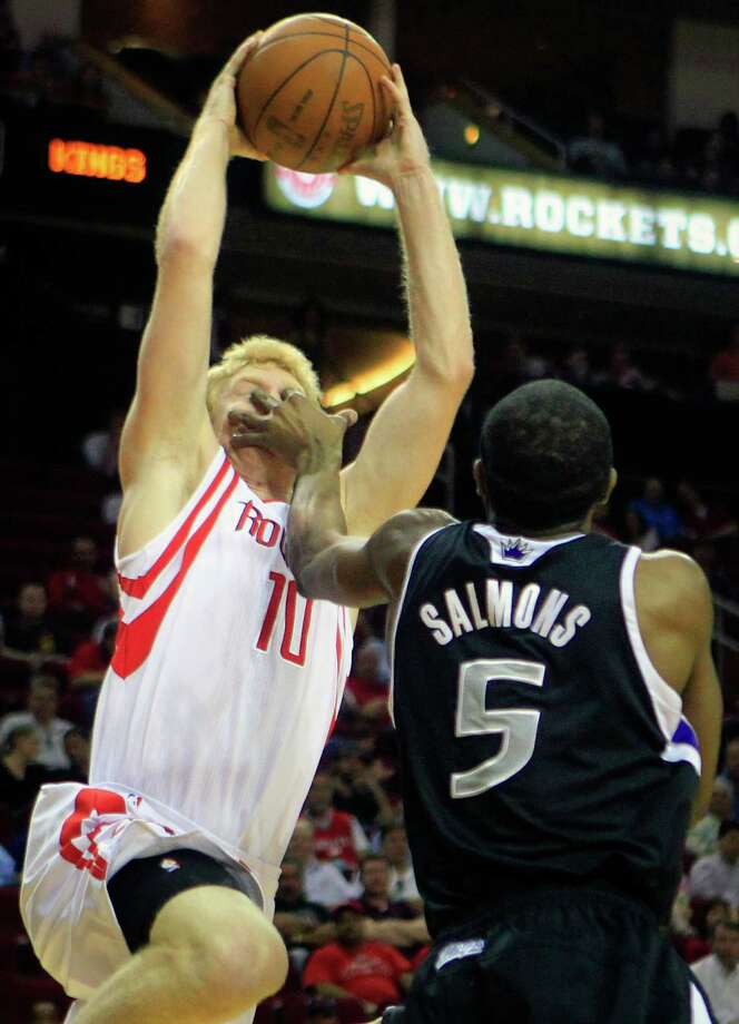 Sacramento Kings shooting guard John Salmons, right, pokes the eyes of Houston Rockets small forward Chase Budinger, left, as he takes a shot in the first half of a basketball game at the Toyota Center Monday, March 26, 2012, in Houston. The Rockets won 113-106. Photo: Cody Duty, Houston Chronicle / © 2011 Houston Chronicle