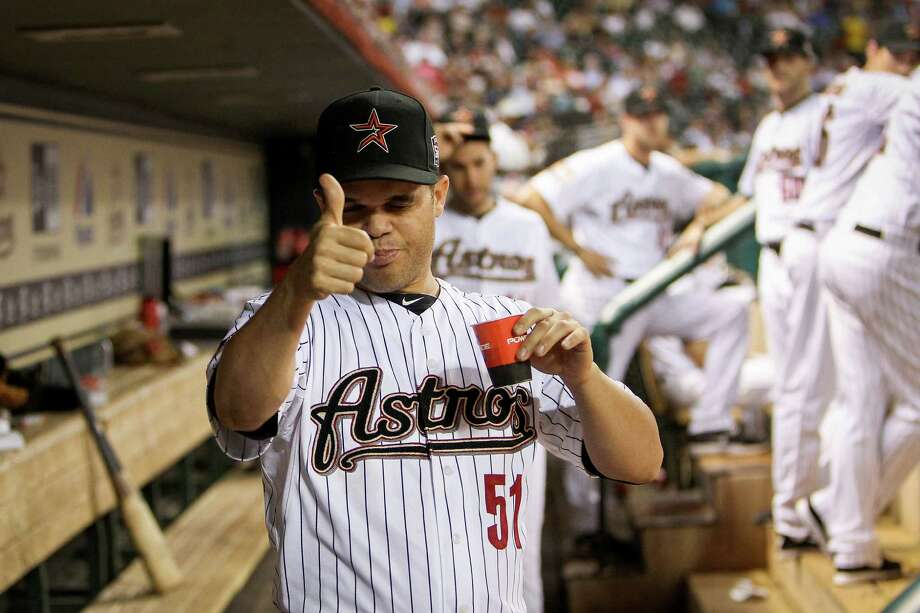 Houston Astros starting pitcher Wandy Rodriguez (51) gives the thumbs up sign in the dugout moments after finding out that he had been traded to Pittsburgh during the fifth inning of an MLB baseball game at Minute Maid Park, Tuesday, July 24, 2012, in Houston. Photo: Karen Warren, Houston Chronicle / © 2012  Houston Chronicle