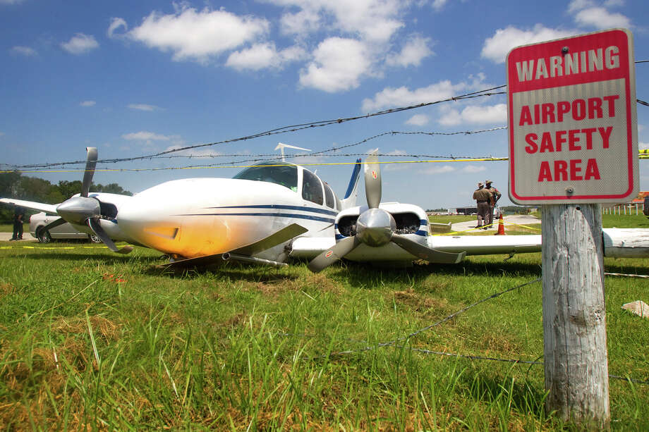 A downed plane is seen just outside West Houston Airport Thursday, Aug. 2, 2012, in Houston. Photo: Cody Duty, Houston Chronicle / © 2011 Houston Chronicle