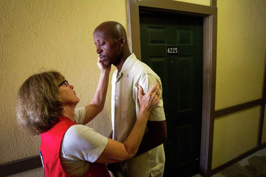 Rosemary Wells, of the VFW Ladies Auxiliary, congratulates Air Force veteran Willie Jefferson outside his new apartment following a ceremony marking the success of Housing Houston's Heroes Friday, Sept. 14, 2012, in Houston. Mayor Annise Parker marked the milestone of successfully housing 101 critically homeless veterans by bringing house warming gifts to four of the formerly homeless vets. Housing Houston's Heroes was launched in May as a pilot project to determine whether it is feasible for local agencies to work together to reduce the incidence of chronic homelessness, especially among returning veterans. Jefferson is one of the veterans to receive housing assistance. Photo: Brett Coomer, Houston Chronicle / © 2012 Houston Chronicle