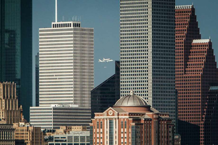 Space Shuttle Endeavour flies over Downtown Houston as it makes it's way to Ellington Field, Wednesday, Sept. 19, 2012, in Houston. Photo: Michael Paulsen, Houston Chronicle / © 2012 Houston Chronicle