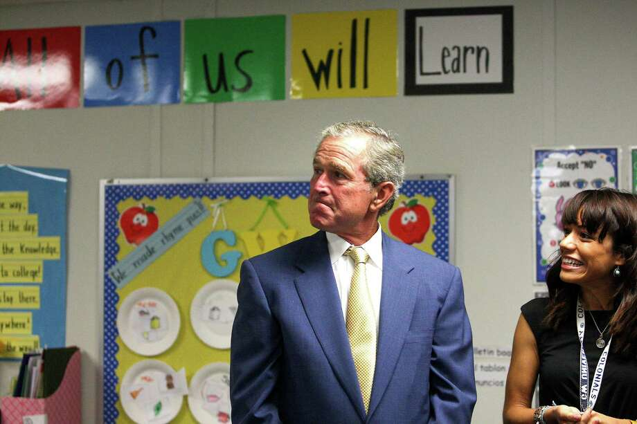 Former President George W. Bush tours Mel Dreyer's Pre-K class at KIPP Explore Academy, Thursday, Sept. 20, 2012, in Houston, before meeting with HISD Superintendent Terry Grier, KIPP officials and others to discuss school leadership. Photo: Karen Warren, Houston Chronicle / © 2012  Houston Chronicle