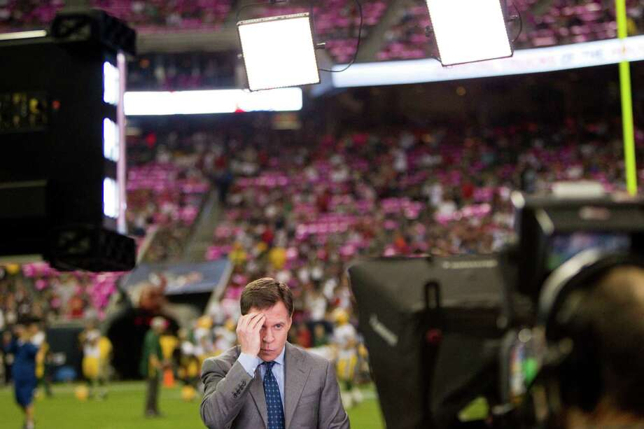 Broadcaster Bob Costas adjusts his hair before going on the air prior to the Houston Texans game against the Green Bay Packers at Reliant Stadium on Sunday, Oct. 14, 2012, in Houston. Photo: Brett Coomer, Houston Chronicle / © 2012  Houston Chronicle