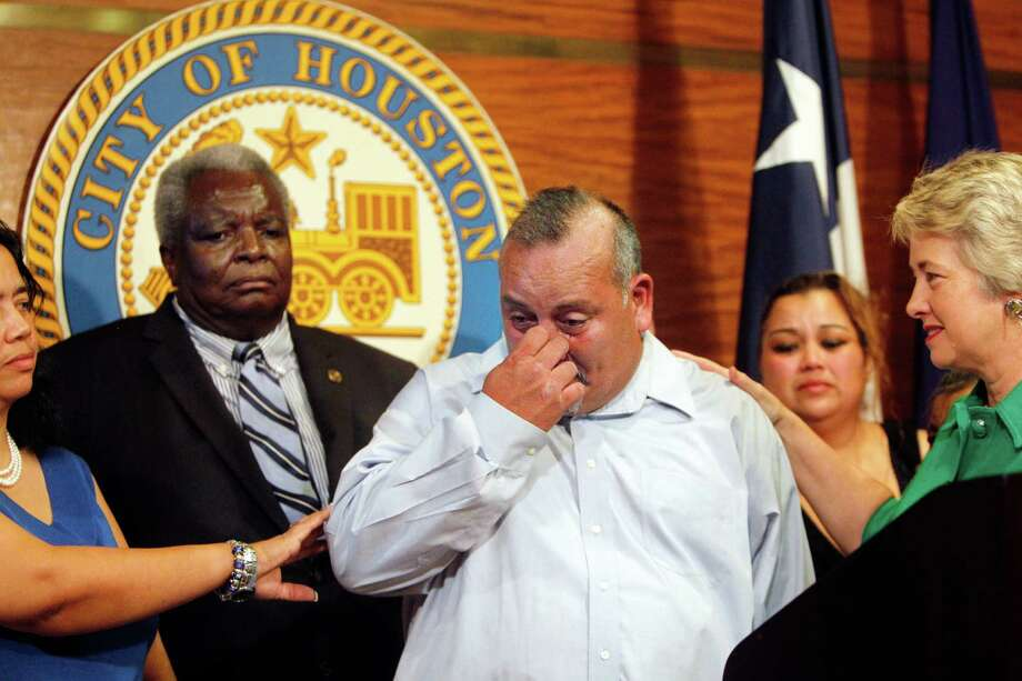 George Rodriguez wipes tears after addressing the media during a the press conference where Houston Mayor Annise Parker announced a $3 million settlement for litigation between the City of Houston and George Rodriguez on Friday, Nov. 2, 2012, in Houston.  The city issued a formal public apology to George Rodriguez, who spent over 17 years behind bars for a rape and kidnapping he did not commit. Photo: Mayra Beltran, Houston Chronicle / © 2012 Houston Chronicle