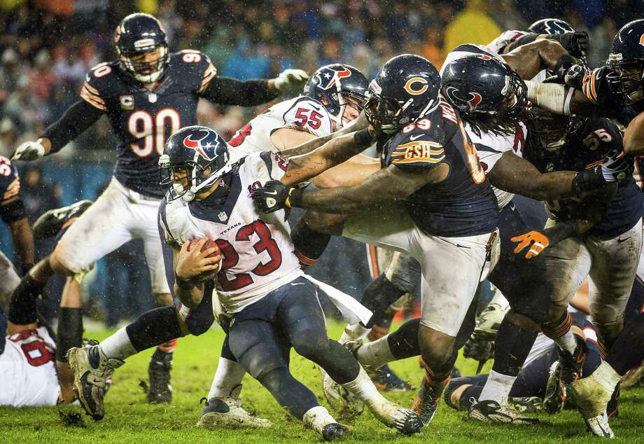 Houston Texans running back Arian Foster (23) tries to get away from Chicago Bears defensive tackle Henry Melton (69) during the fourth quarter of an NFL football game at Soldier Field on Monday, Nov. 12, 2012, in Chicago. Photo: Smiley N. Pool, Houston Chronicle / © 2012  Houston Chronicle