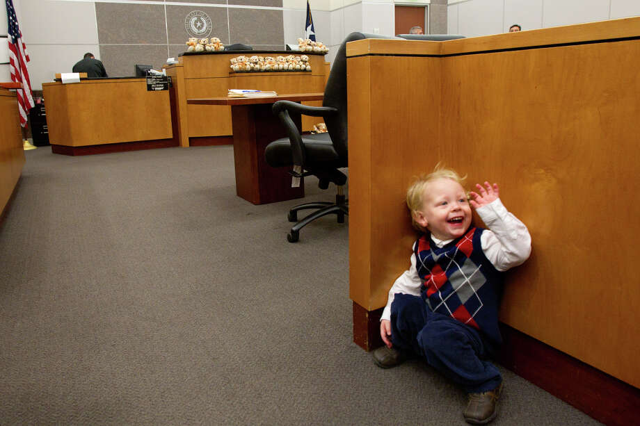 Aidan Walsh, 2, in the courtroom before a mass adoption at the Juvenile Justice Center Friday, Nov. 16, 2012, in Houston. Over 70 Child Protective Services children were adopted during the event. Photo: Cody Duty, Houston Chronicle / © 2012 Houston Chronicle