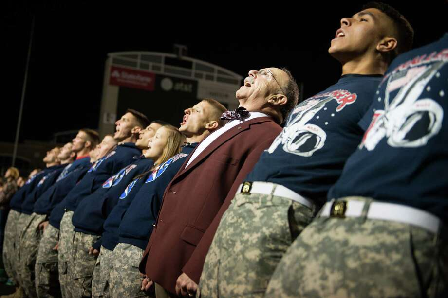Texas A&M president R. Bowen Loftin lines up with members of the Corps of Cadets during Midnight Yell Practice at Kyle Field on Saturday, Nov. 17, 2012, in College Station. Photo: Smiley N. Pool, Houston Chronicle / © 2012  Houston Chronicle