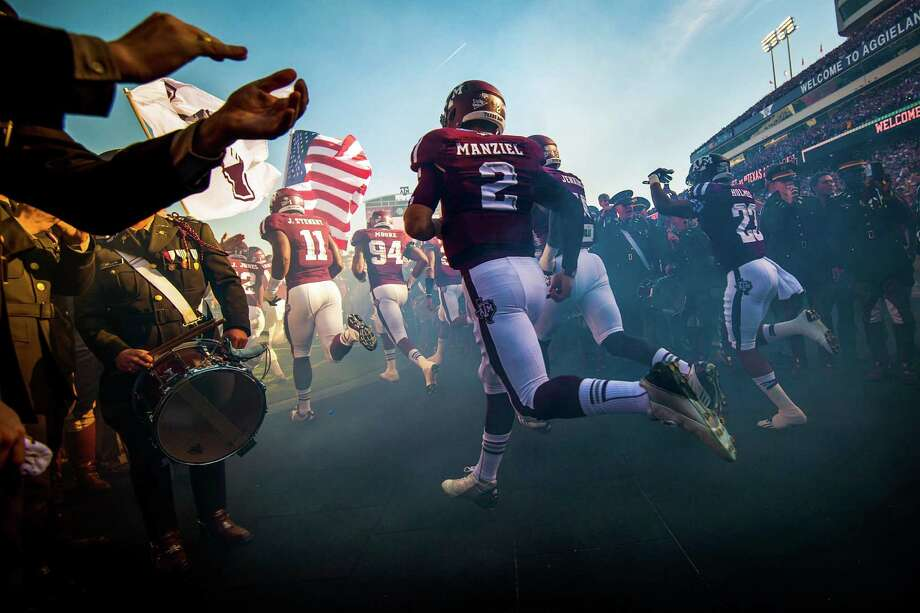 Texas A&M quarterback Johnny Manziel (2) runs onto the field before facing Sam Houston State in a college football game at Kyle Field, Saturday, Nov. 17, 2012, in College Station. Photo: Smiley N. Pool, Houston Chronicle / © 2012  Houston Chronicle