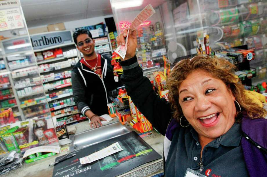 Raising her Power Ball ticket in the air, Hortcina Martinez, who plays power ball weekly, shouts in excitement in hopes of winning jackpot from a ticket purchased at Oscar's Food Mart #1 on Tuesday, Nov. 27, 2012, in Houston.  Wednesday's Powerball jackpot was raised to $500 million from $425 million. Photo: Mayra Beltran, Houston Chronicle / © 2012 Houston Chronicle