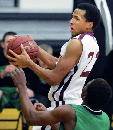 Watervliet's #23 Shane Ray with a hard fought rebound in Saturday's game against Bishop Ludden at th