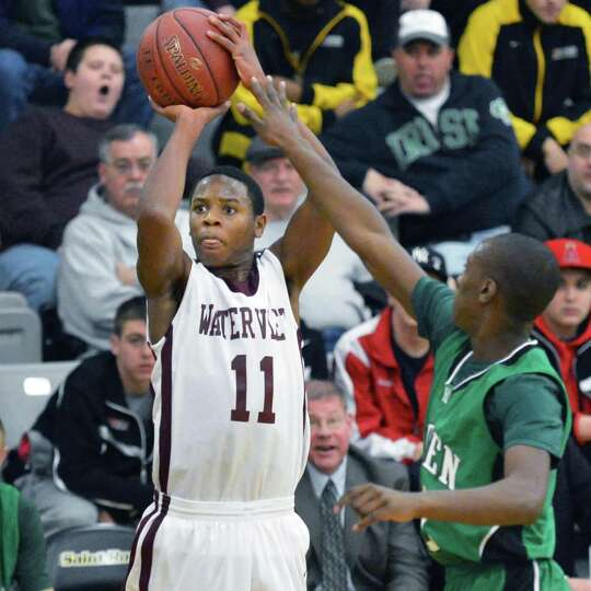 Watervliet's #11 Will Francis with a jump shot during Saturday's game against Bishop Ludden at the C