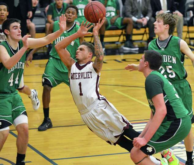 Watervliet's #1 Jordan Gleason gets fouled during Saturday's game against Bishop Ludden at the Colle
