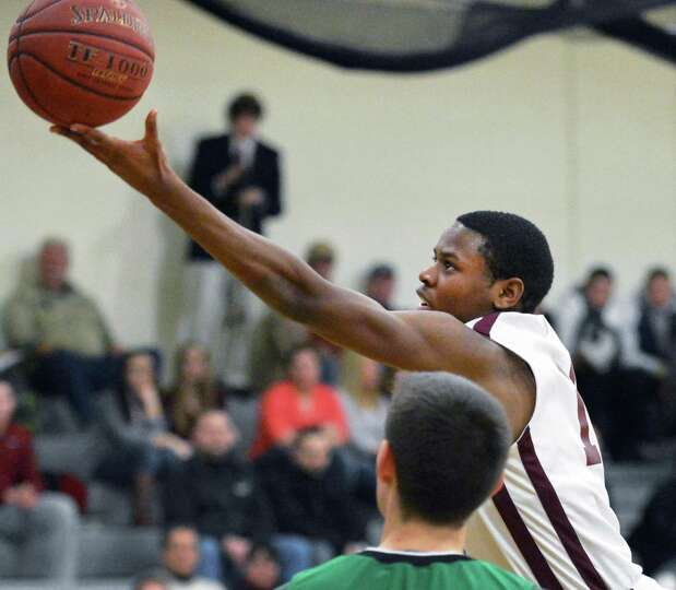 Watervliet's #11 Will Francis drives to the hoop in Saturday's game against Bishop Ludden at the Col