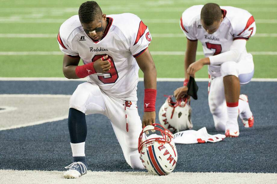 Lamar defensive back Cravon Rogers (9) and quarterback Darrell Colbert (7) kneels in prayer before the Class 5A Division I state championship football game against Allen at Cowboys Stadium on Saturday, Dec. 22, 2012, in Arlington. Photo: Smiley N. Pool, Houston Chronicle / © 2012  Houston Chronicle