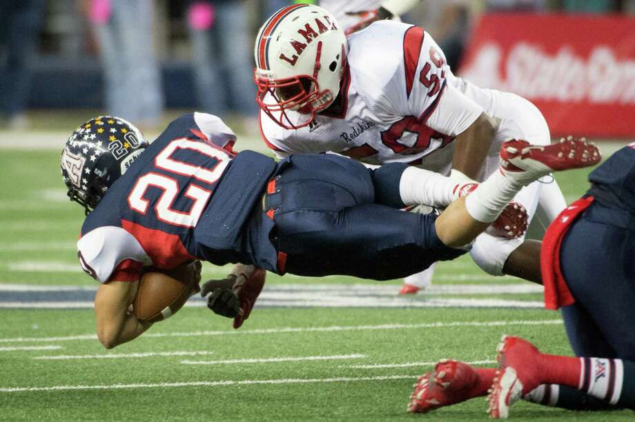 Allen running back Marcus Ward (20) is upended by Lamar linebacker Kyran Mitchell (59) during the first half of the Class 5A Division I state championship football game at Cowboys Stadium on Saturday, Dec. 22, 2012, in Arlington. Photo: Smiley N. Pool, Houston Chronicle / © 2012  Houston Chronicle