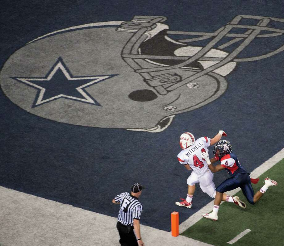 Lamar running back Cory Mitchell (44) scores a touchdown past Allen defensive back Mayomi Olootu (4) during the first half of the Class 5A Division I state championship football game at Cowboys Stadium on Saturday, Dec. 22, 2012, in Arlington. Photo: Smiley N. Pool, Houston Chronicle / © 2012  Houston Chronicle