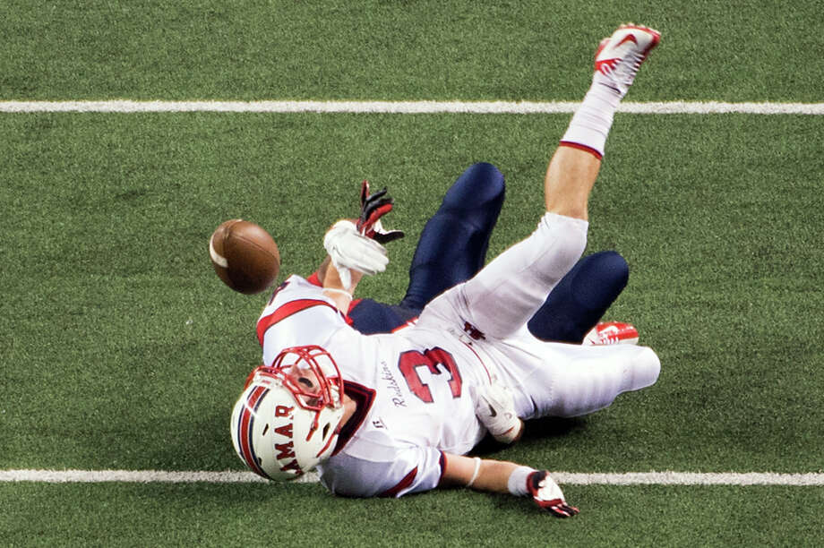 Lamar wide receiver Beau Wells (3) fumbles as he is hit by Allen defensive back Mayomi Olootu (4) during the first half of the Class 5A Division I state championship football game at Cowboys Stadium on Saturday, Dec. 22, 2012, in Arlington. Photo: Smiley N. Pool, Houston Chronicle / © 2012  Houston Chronicle