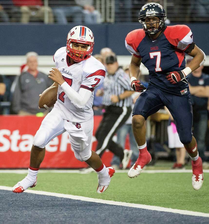 Lamar quarterback Darrell Colbert (7) scores on a quarterback sneak past Allen linebacker Tay Evans during the first half of the Class 5A Division I state championship football game at Cowboys Stadium on Saturday, Dec. 22, 2012, in Arlington. Photo: Smiley N. Pool, Houston Chronicle / © 2012  Houston Chronicle