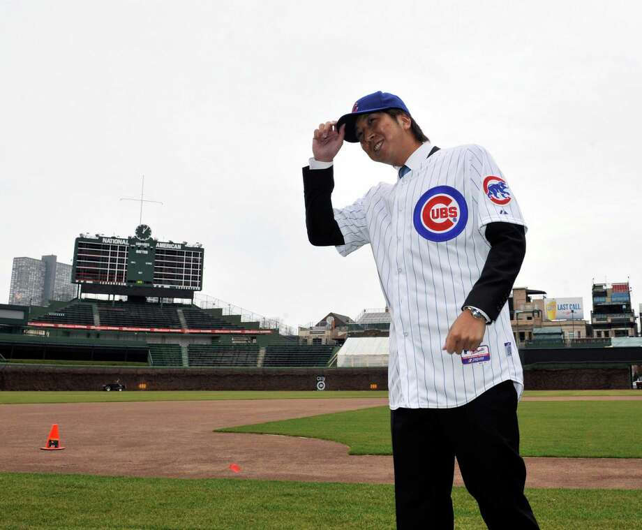 CHICAGO, IL - DECEMBER 7: Chicago Cubs new pitcher Kyuji Fujikawa  poses for photos on December 7, 2012 at Wrigley Field in Chicago, Illinois.  (Photo by David Banks/Getty Images) Photo: David Banks / 2012 Getty Images