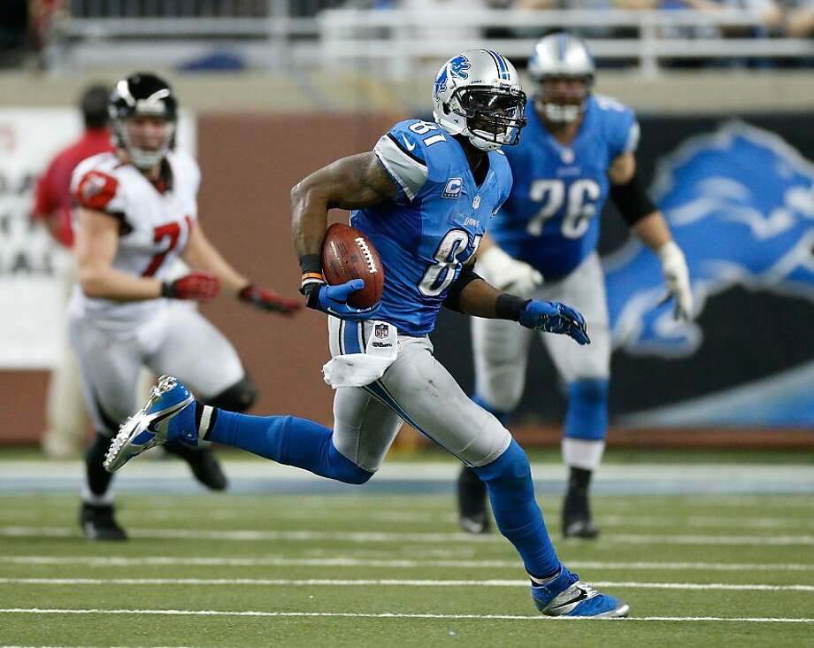DETROIT, MI - DECEMBER 22:  Calvin Johnson #81 of the Detroit Lions runs for 26 yards after a fourth quarter catch while playing the Atlanta Falcons at Ford Field on December 22, 2012 in Detroit, Michigan.  Johnson broke the NFL single season yardage record formally held by Jerry Rice during this play. (Photo by Gregory Shamus/Getty Images) Photo: Gregory Shamus, Getty Images