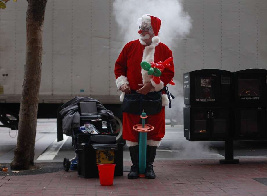 Ready for holiday shoppers to come his way, Street performer Kenny the Clown sets up on Market Street in San Francisco, Calif. (Mike Kepka / The Chronicle)