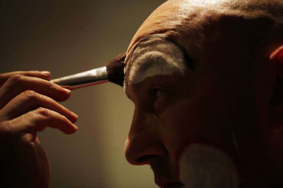 Kenneth Kahn transforms himself into Kenny the Clown in a public bathroom on Market Street  in San Francisco, Calif. (Mike Kepka / The Chronicle)