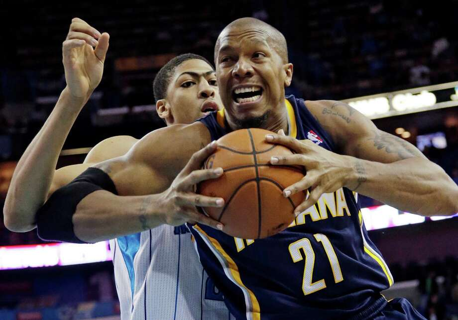 Pacers forward David West, right, had a lesson for No. 1 overall pick Anthony Davis and the Hornets as he scored 20 of his 25 points in the second half. Photo: Dave Martin, STF / AP