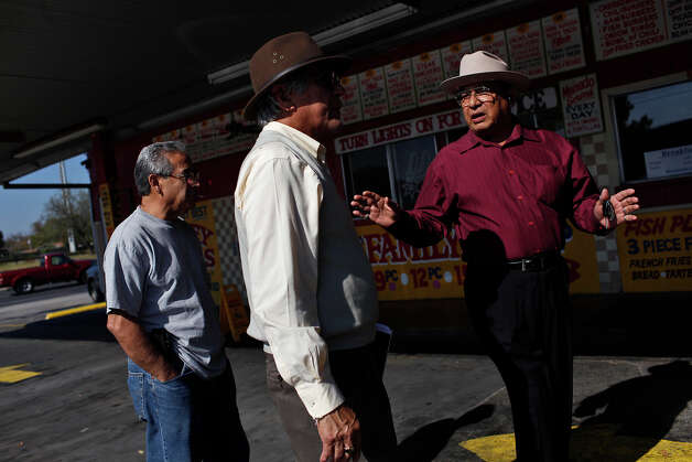 Juan Guajardo, right, talks with Louie Garcia, left, and Luz  H. Gallegos after the monthly gathering of the Ghost Town Survivors at Oscar's Taco House in San Antonio on Thursday, Dec. 6, 2012. Photo: Lisa Krantz, San Antonio Express-News / © 2012 San Antonio Express-News