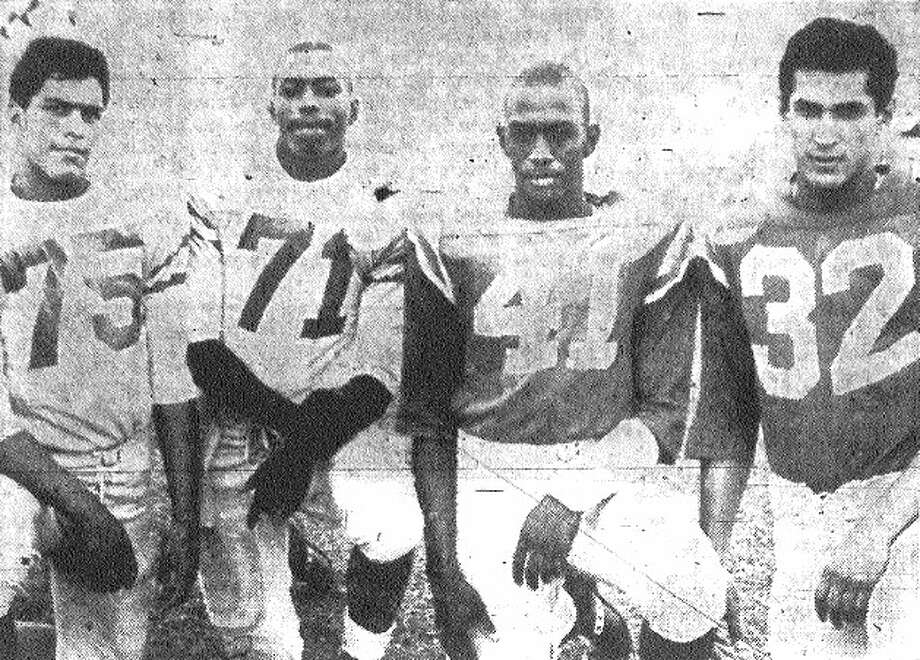 Brackenridge backs (from left) Victor Castillo, quarterback; Warren McVea, halfback; Robert Wade, fullback; and Pete Bautista, halfback. Floyd Boone (not pictured) shared duties with Wade at fullback. File photo
