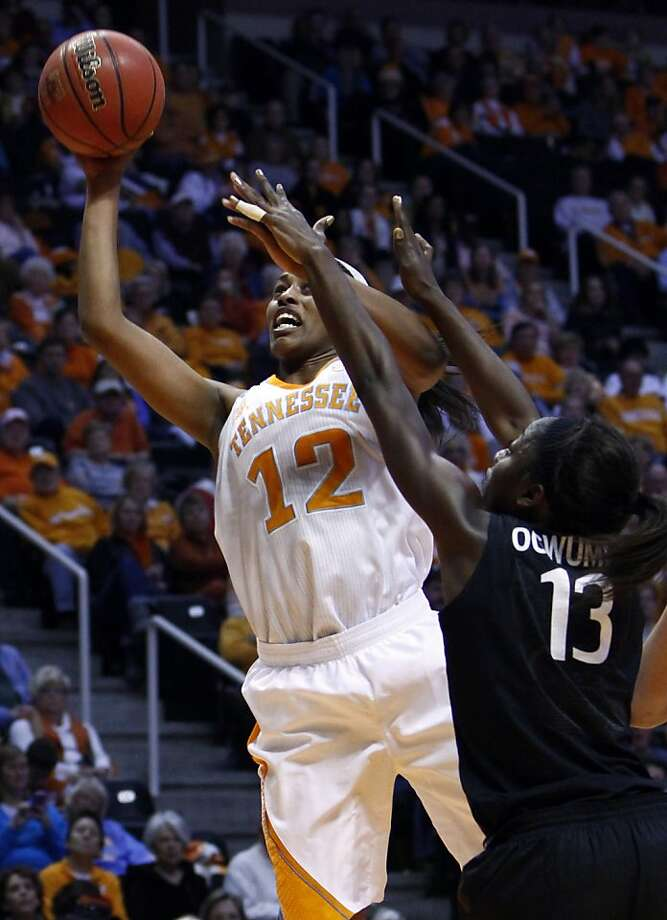 Tennessee forward Bashaara Graves (12) shoots over Stanford forward Chiney Ogwumike (13) in the second half of an NCAA college basketball game on Saturday, Dec. 22, 2012, in Knoxville, Tenn. Stanford won 73-60. (AP Photo/Wade Payne) Photo: Wade Payne, Associated Press